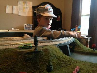Here is my newest customer.  4 year old AJ from Seattle, Washington just received delivery of his 5x8 Lionel layout.  AJ just moved to Seattle and the truck with all of his model trains has not arrived yet... Hang in there AJ, the trains will arrive soon.
